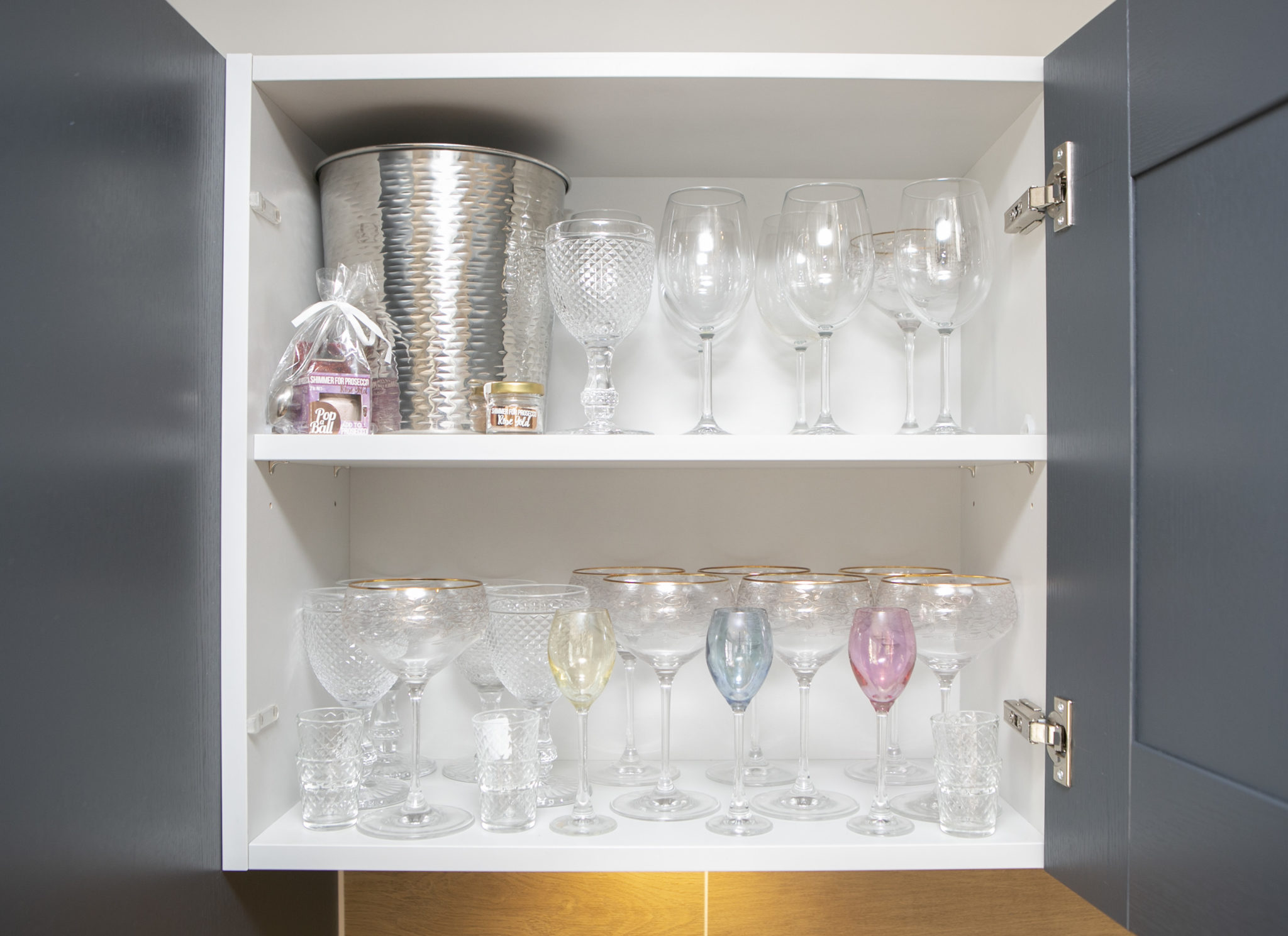 Kitchen shelf tidy and organised with glasses